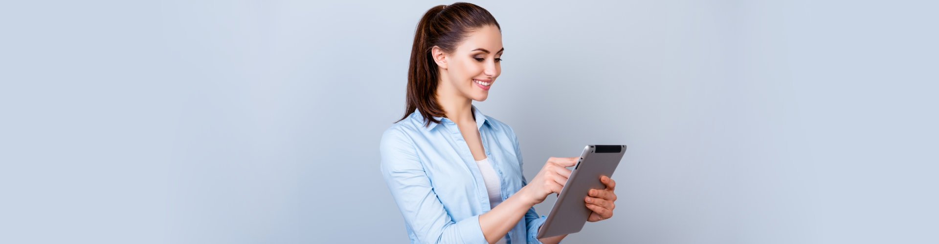 a lady using a tablet