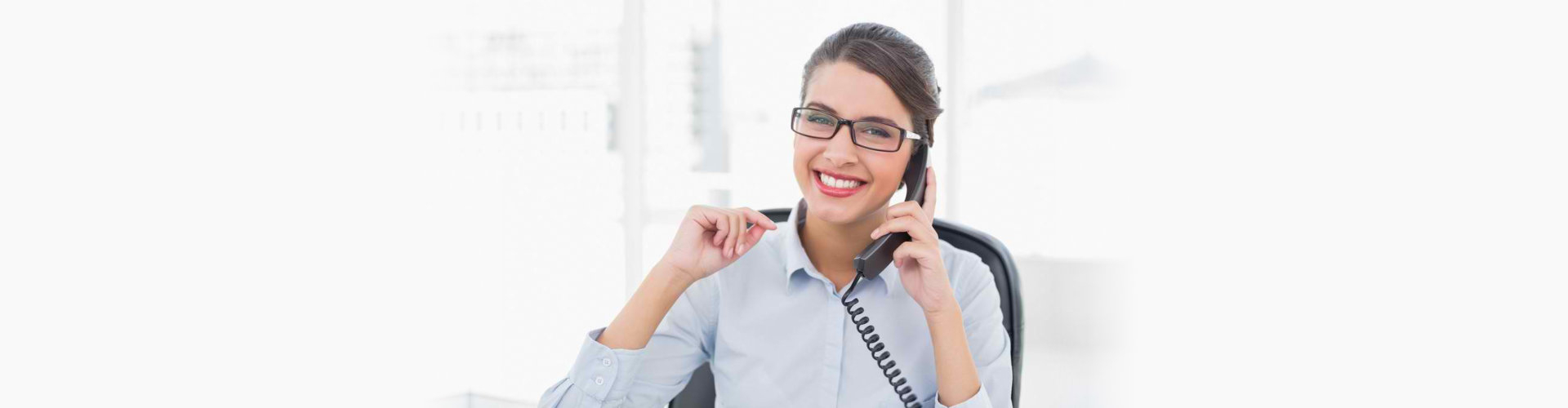 a lady smiling while having a call